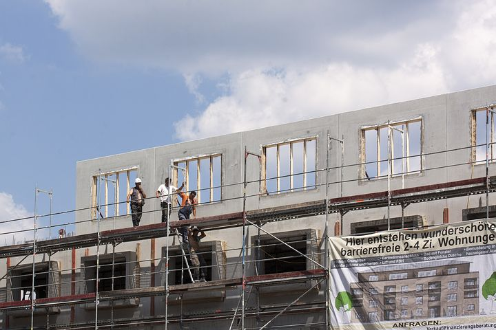 group of people working at a scaffolding