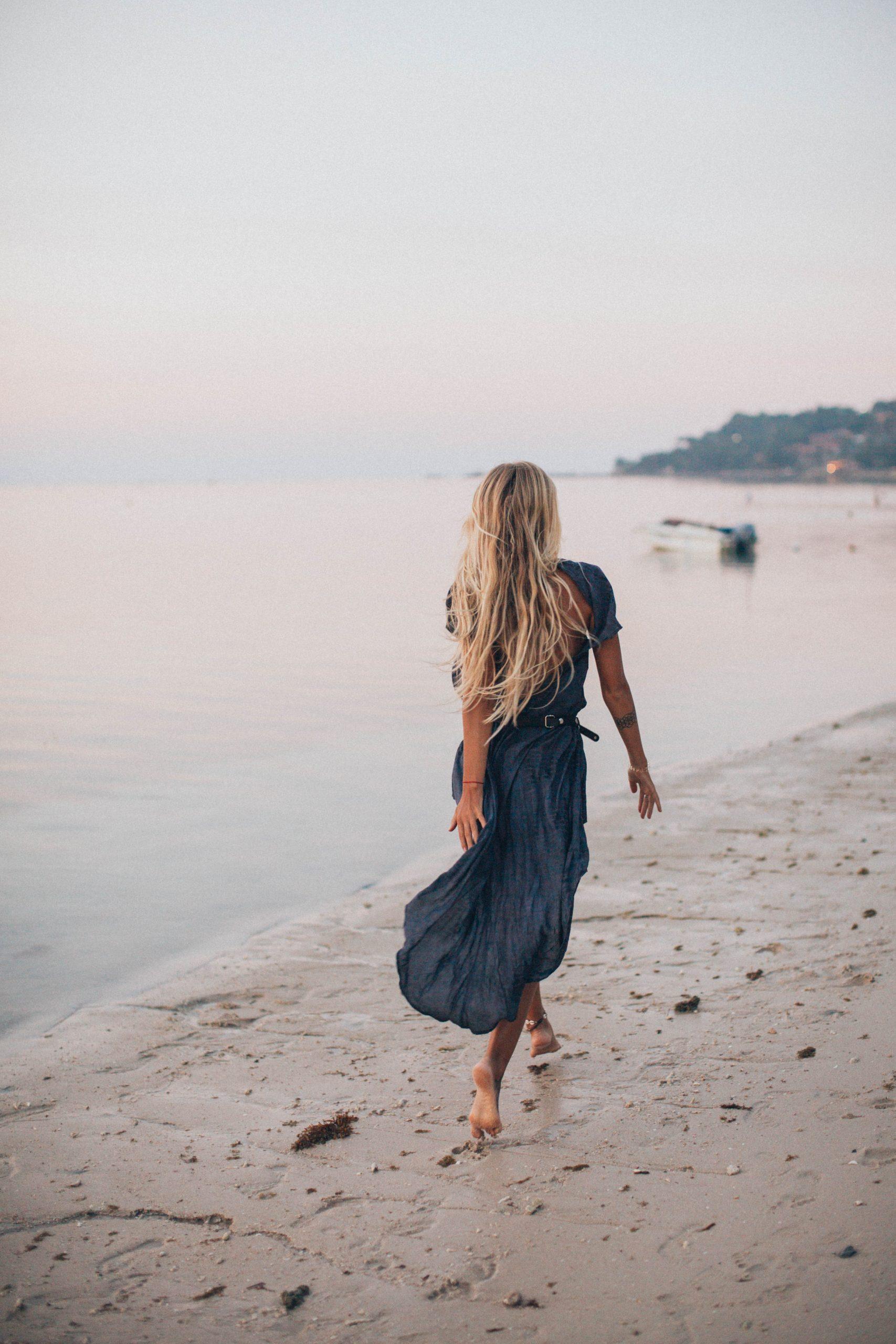 Woman wearing a dress in a beach