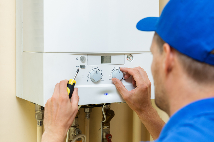 Hot water plumber in Canberra installing and regulating the system