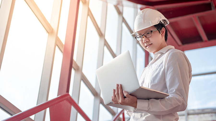 Engineer while using a construction software programs