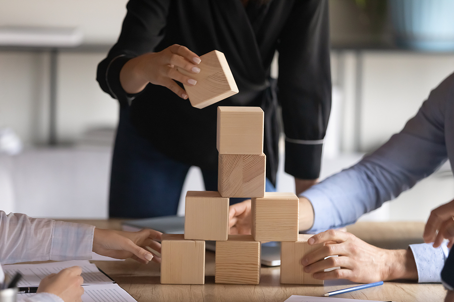 Employees playing with wooden cubes