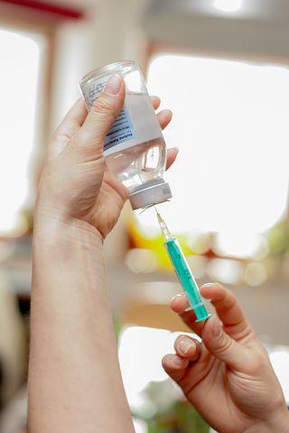 Worker getting corporate flu vaccines